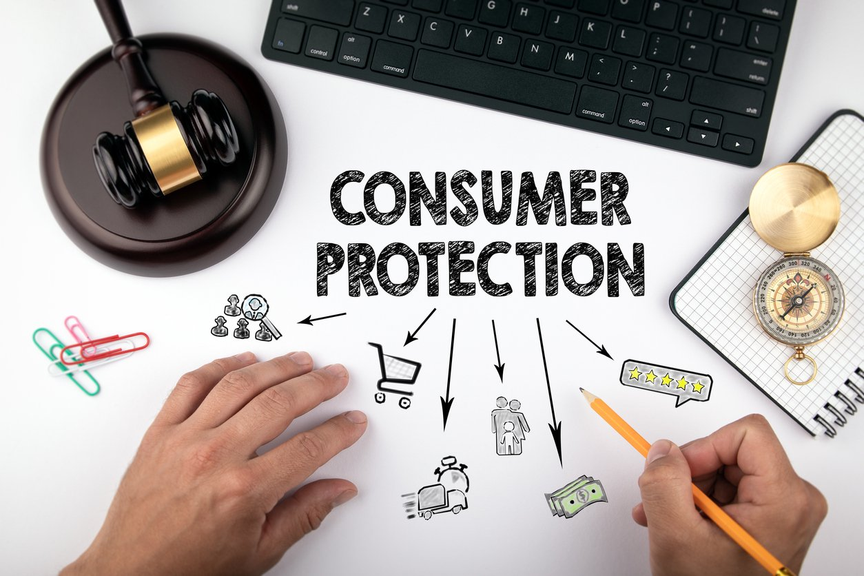 consumer protection written on a desk with a gavel sitting above it