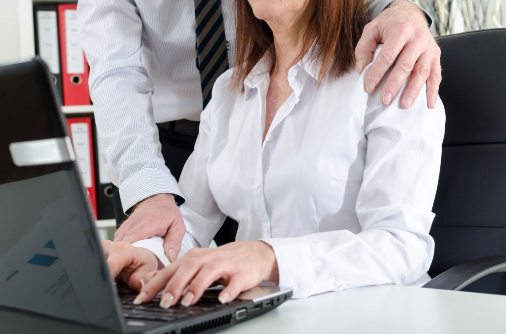 Woman Working Being Touched Inappropriately by Coworker