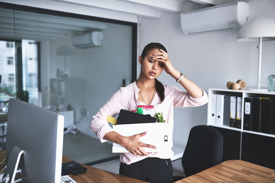 Stressed Out Woman Packing Up Desk