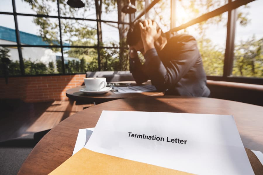 Stressed man and termination letter